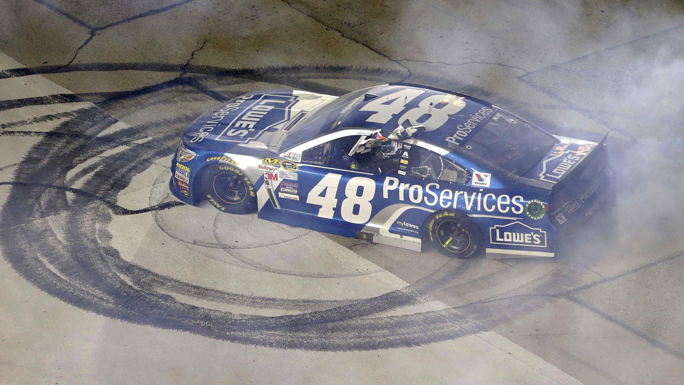 Jimmie Johnson makes doughnuts after winning the Duck Commander 500 NASCAR auto race at Texas Motor Speedway on April 11, 2015 in Fort Worth, Texas.