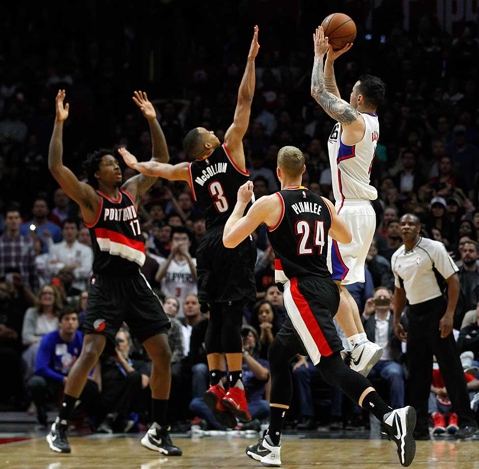 Los Angeles Clippers guard J.J. Redick shoots a game-winning buzzer-beater as Portland's Ed Davis, C.J. McCollum (3) and Mason Plumlee defend. The Clippers won 96-94.