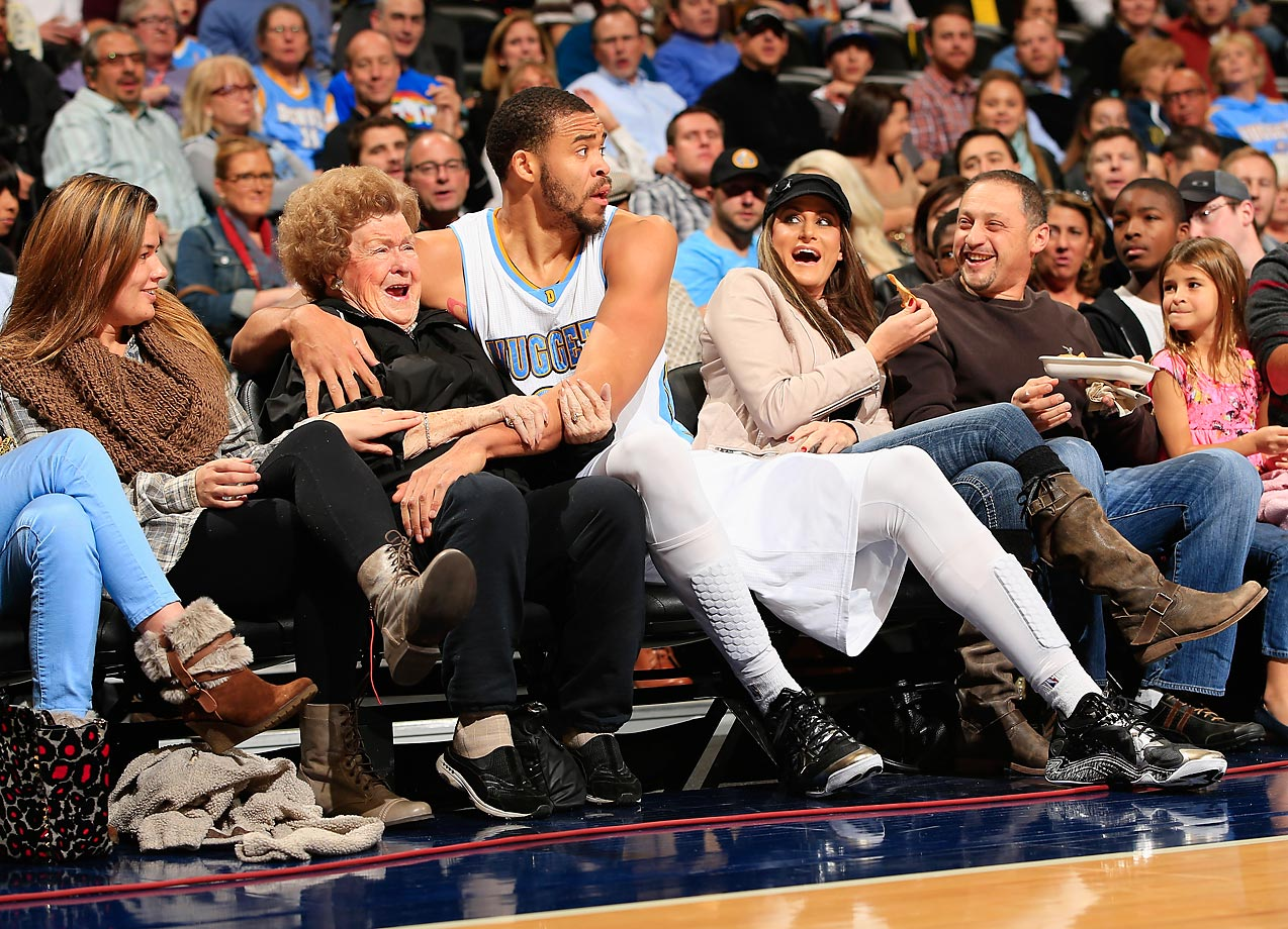 JaVale McGee of the Denver Nuggets jokes with a spectator after saving the ball against the New Orleans Pelicans.