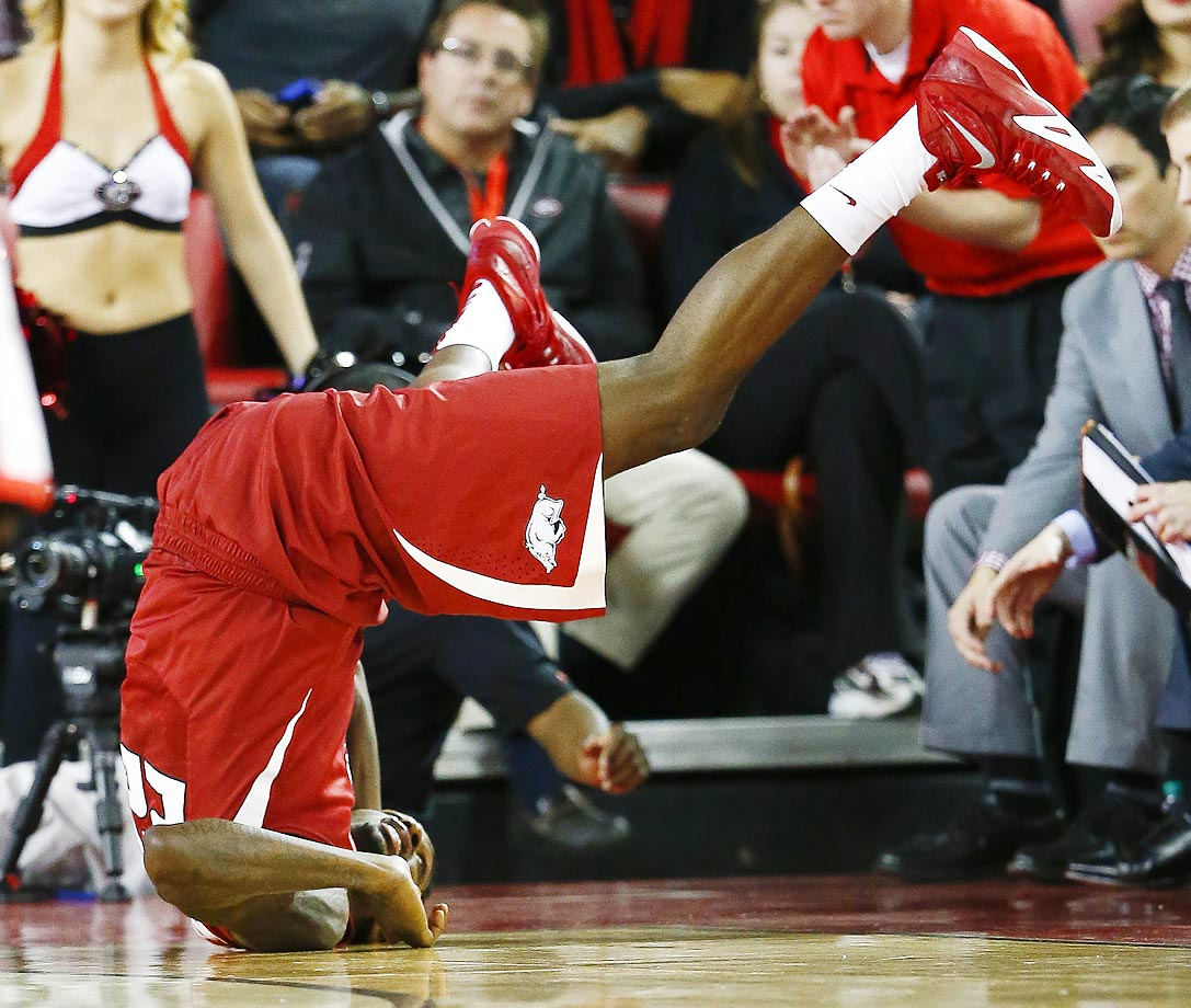 Arkansas forward Jacorey Williams flips after diving for a loose ball against Georgia.