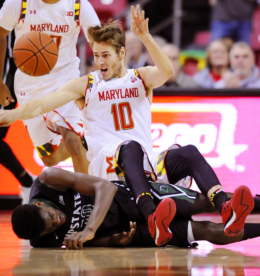 Maryland forward Jake Layman loses the ball after colliding with USC Upstate forward Josh Cuthbertson.