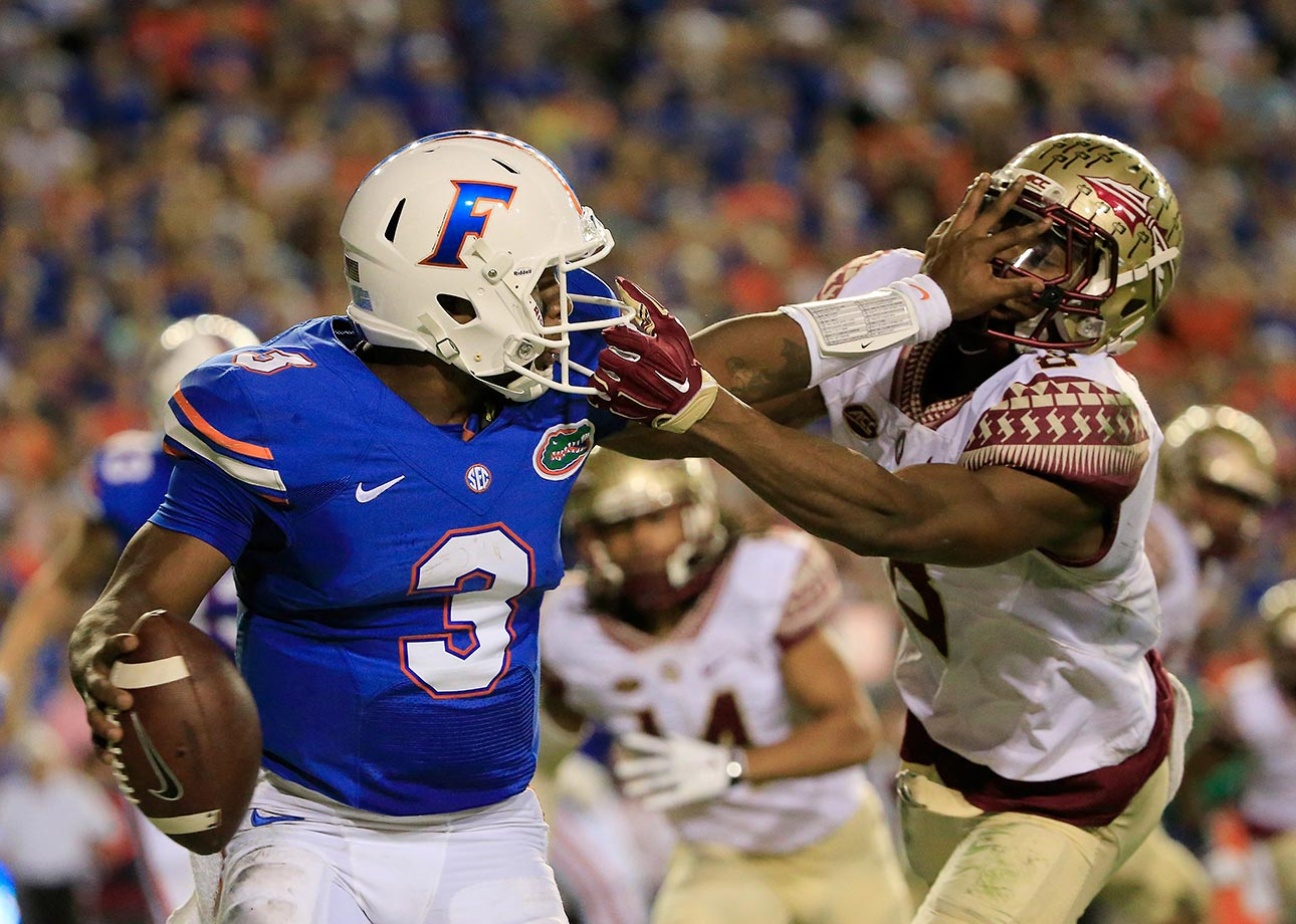 Jalen Ramsey of Florida State attempts to tackle Treon Harris of Florida.