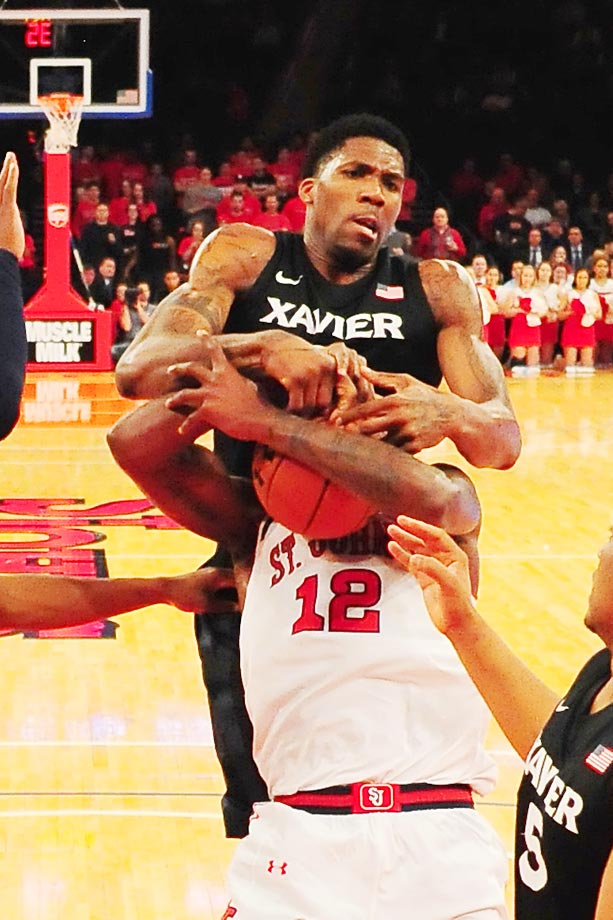 Xavier Musketeers forward Jalen Reynolds fights for a rebound with St. John's Red Storm forward Chris Obekpa.