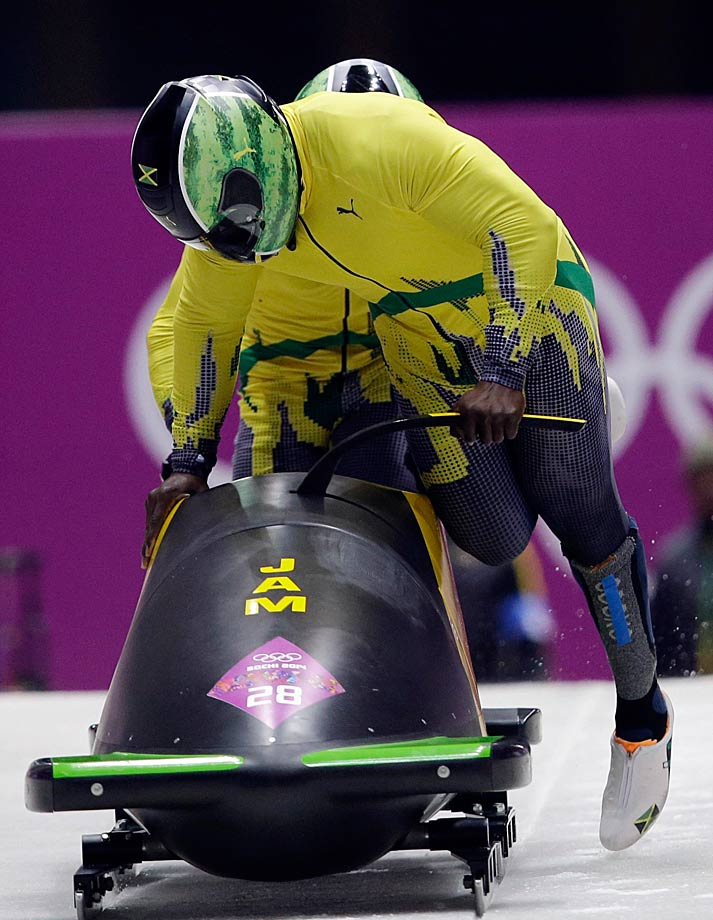 The team from Jamaica, piloted by Winston Watts and brakeman Marvin Dixon, start their first run during the men's two-man bobsled competition.