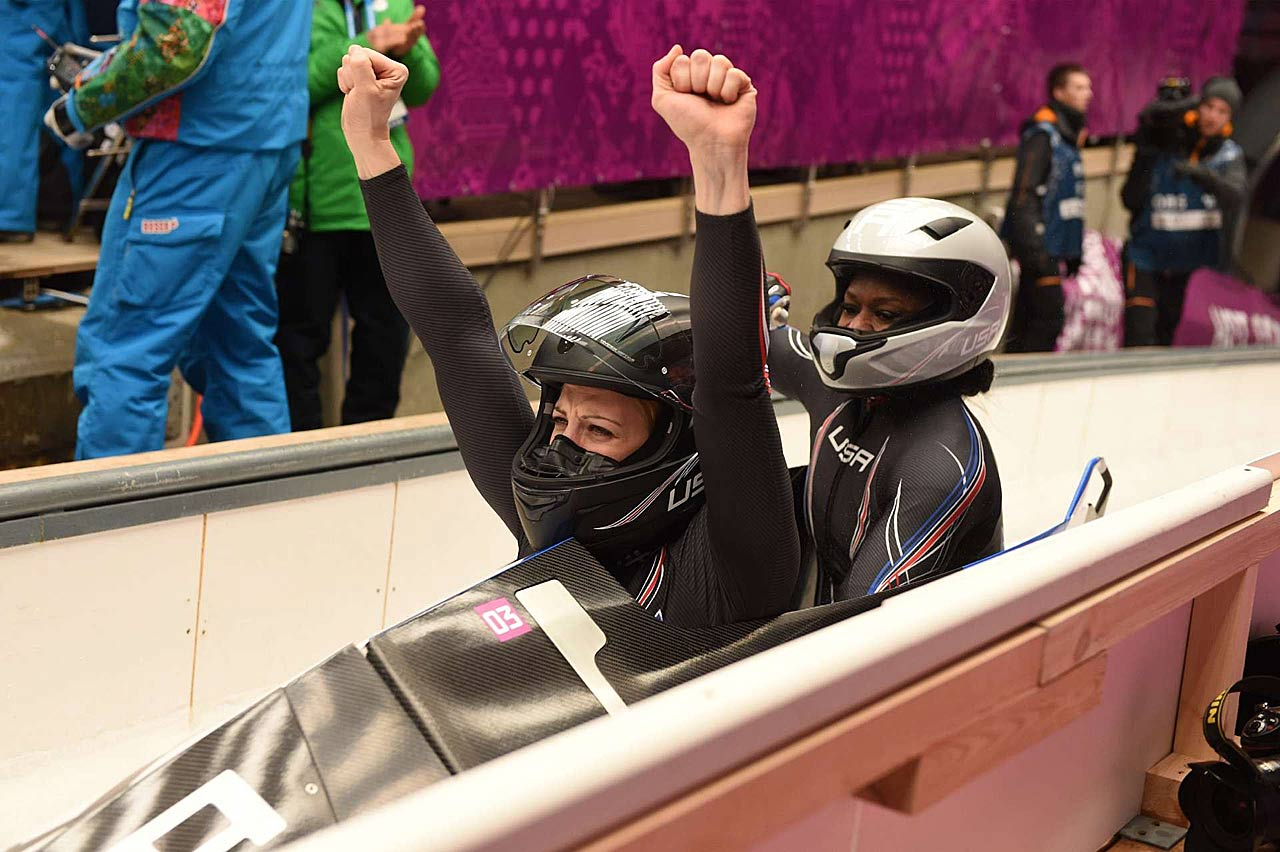 Jamie Greubel and Aja Evans celebrate their third-place finish, which gave the U.S. two Olympic women's bobsled medal winners for the first time.