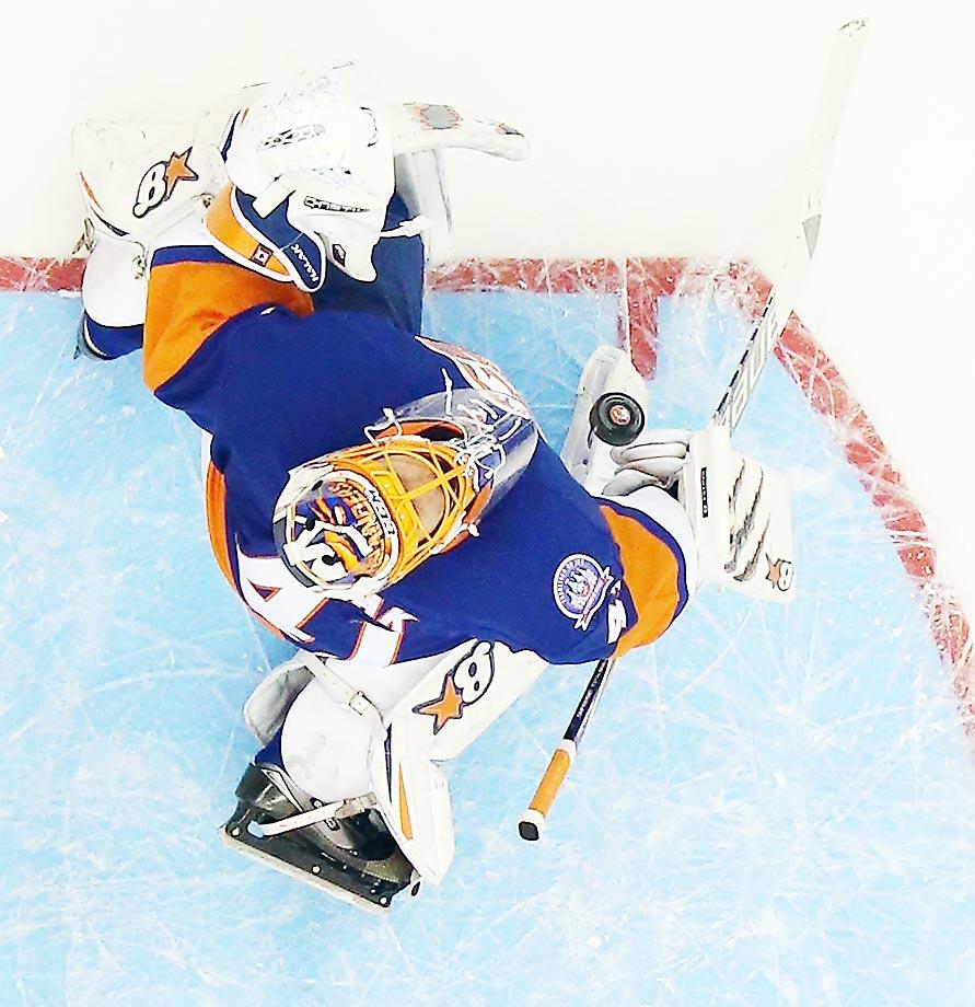 Jaroslav Halak of the New York Islanders makes a save against the Edmonton Oilers at the Nassau Veterans Memorial Coliseum.  The Islanders won 3-2.