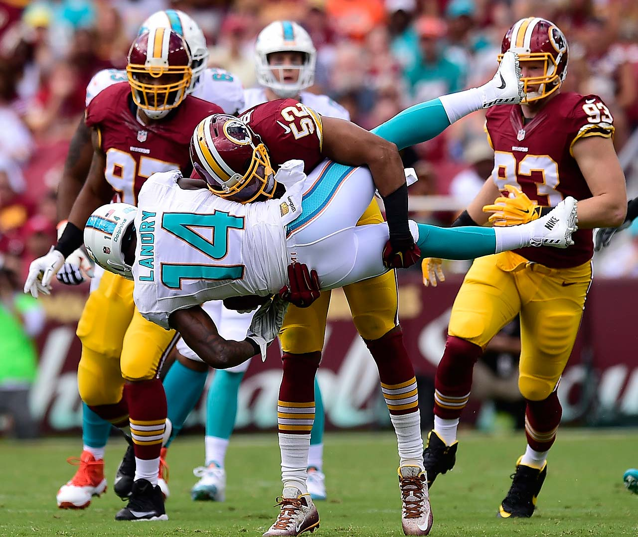 Jarvis Landry is taken down hard by the Redskins.