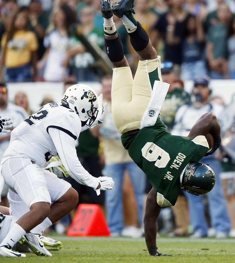 Jasen Oden Jr. of Colorado State lands on his hand after being hit by a Colorado player.