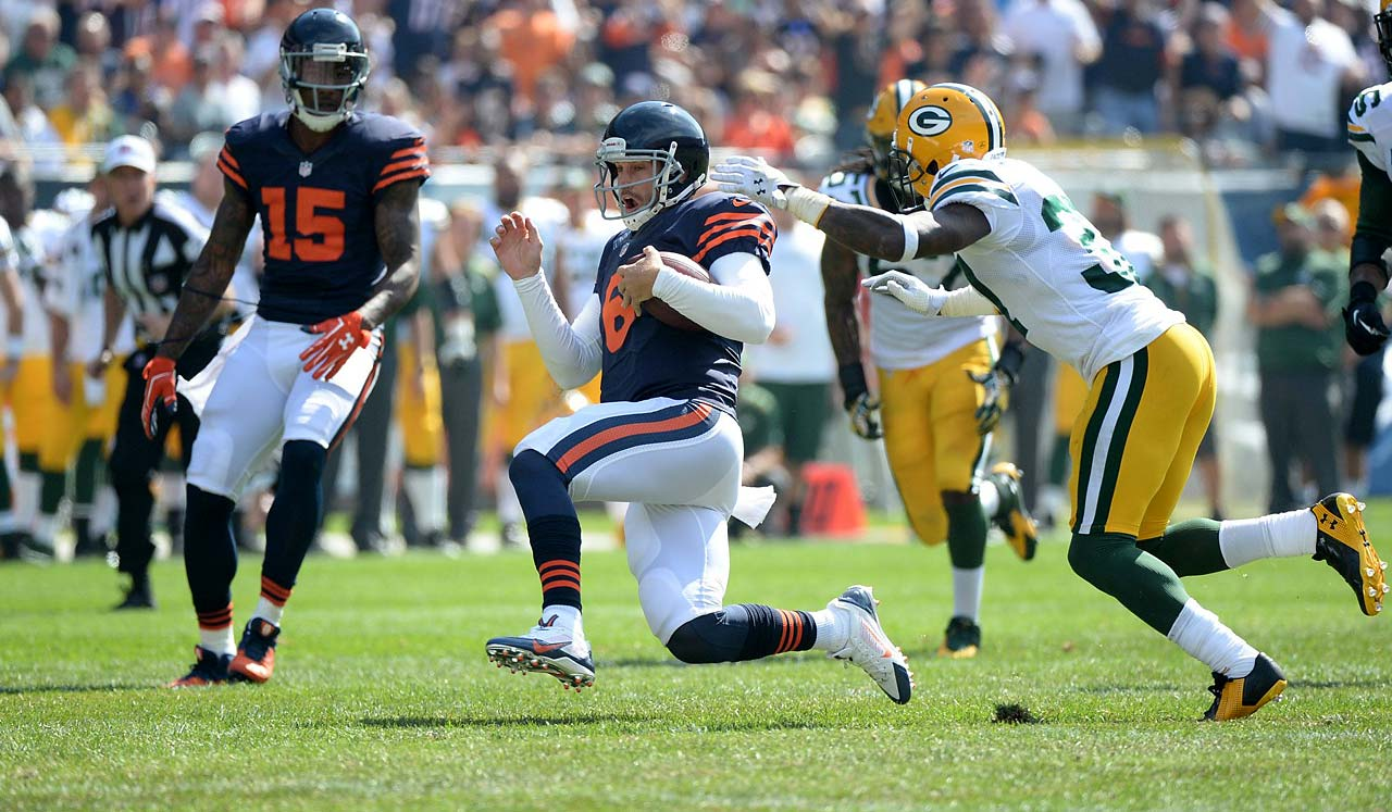 Jay Cutler slides to wrap up one of his runs.