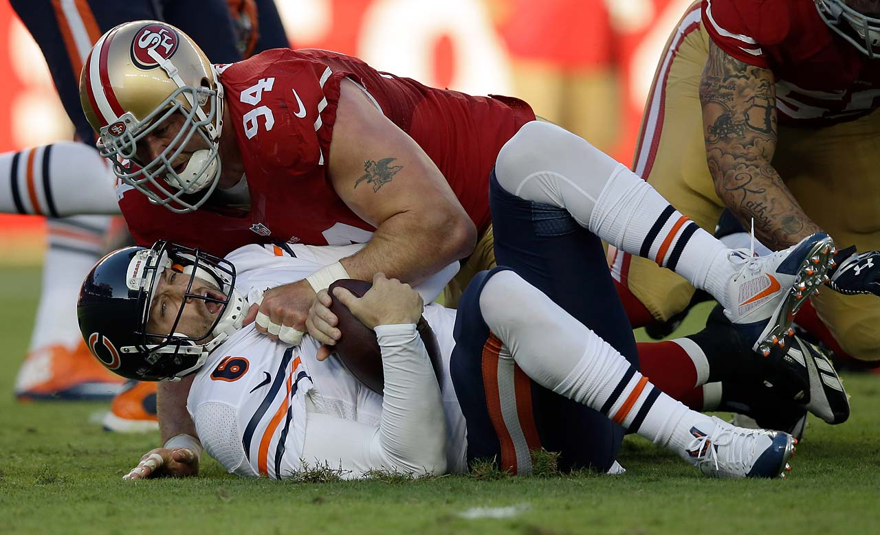 Quarterback Jay Cutler of the Chicago Bears is sacked by defensive end Justin Smith of the San Francisco 49ers.