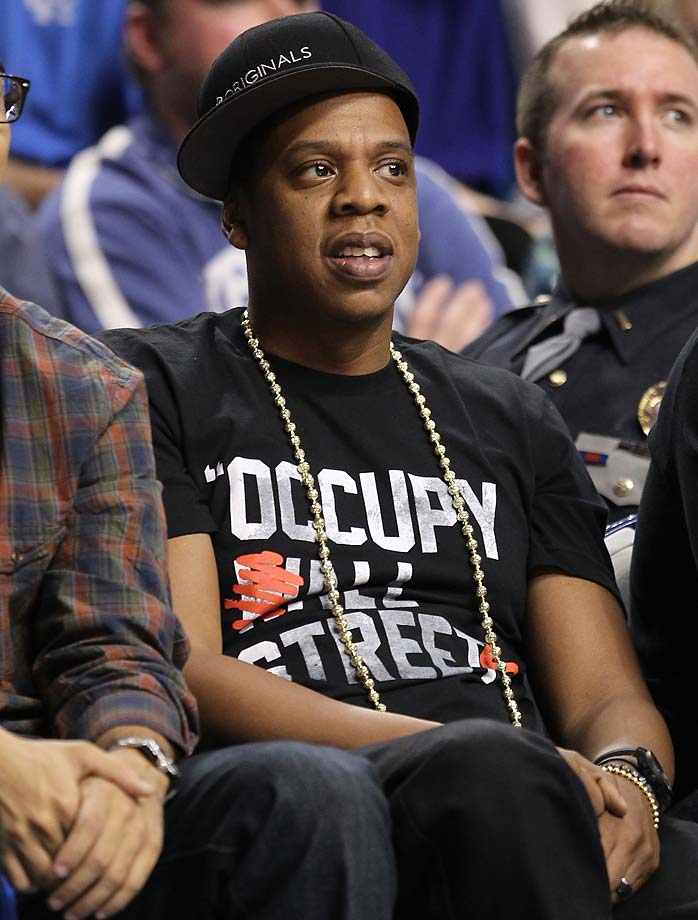 Jay-Z watches the 2011 action during the Kentucky Wildcats game against Louisville at Rupp Arena .