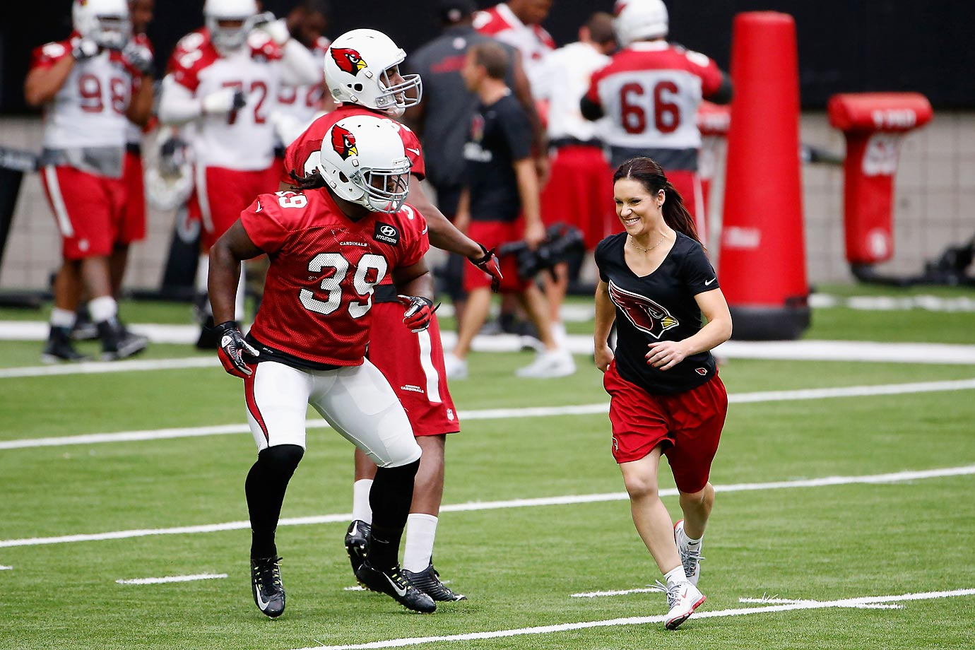 The first woman coach in the NFL, Jen Welter is helping to direct the Arizona Cardinals linebackers during training camp. Here's a look at Welter in action.