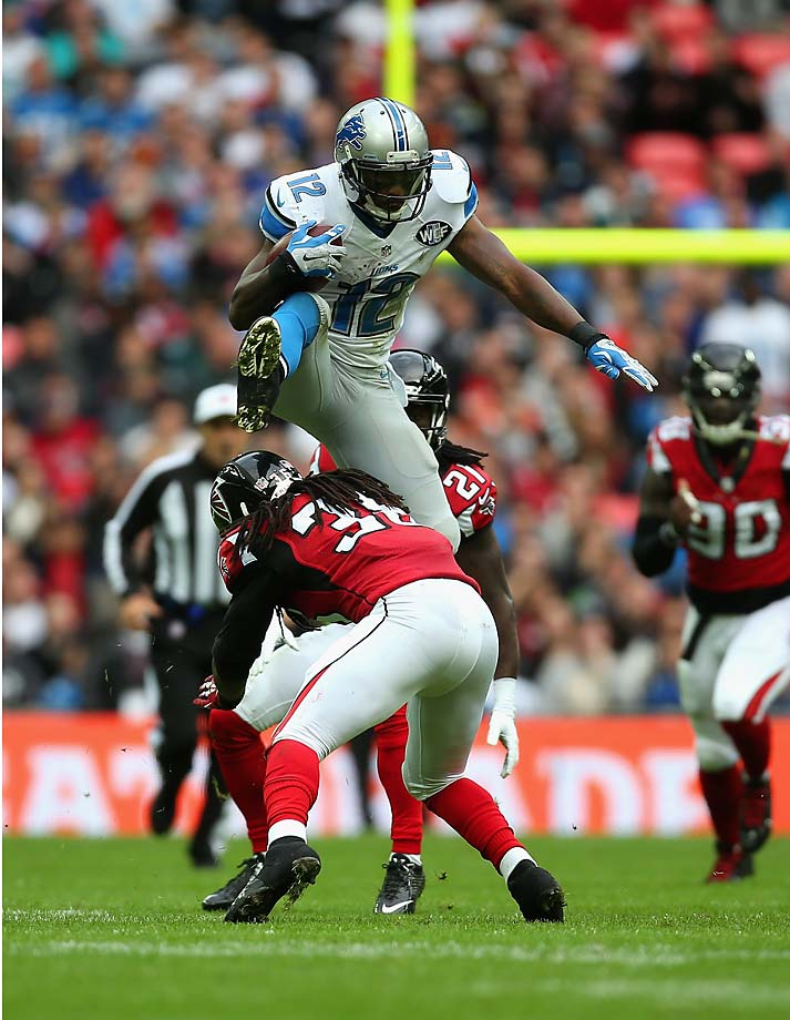Jeremy Ross leaps over a challenge from  Kemal Ishmael of the Atlanta Falcons during the Detroit Lions' victory in London.