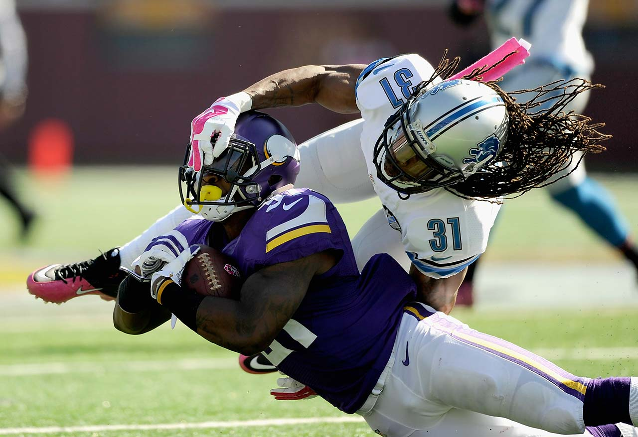 Rashean Mathis of the Detroit Lions tackles Jerick McKinnon of the Minnesota Vikings.