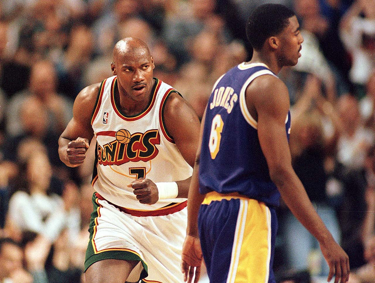 Jerome Kersey pumps his fist as he runs past Eddie Jones during a Western Conference semifinal.