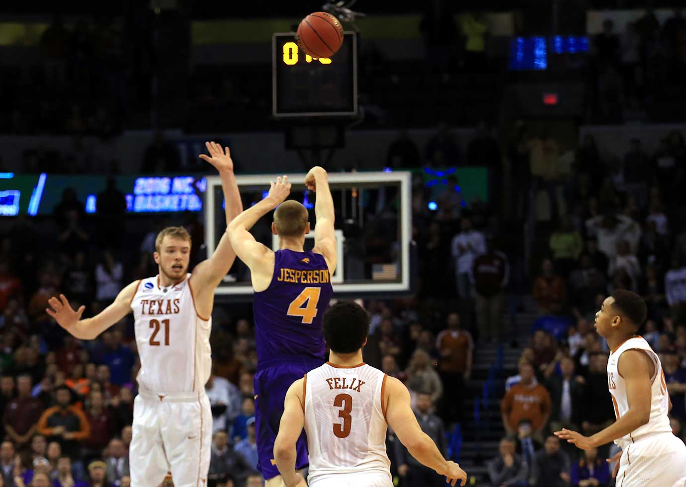 Here are some of the images that caught our eye on an upset-laden day in the NCAA Tournament, including Paul Jesperson of the Northern Iowa Panthers hitting a half court three-pointer at the buzzer to defeat the Texas Longhorns 75-72.