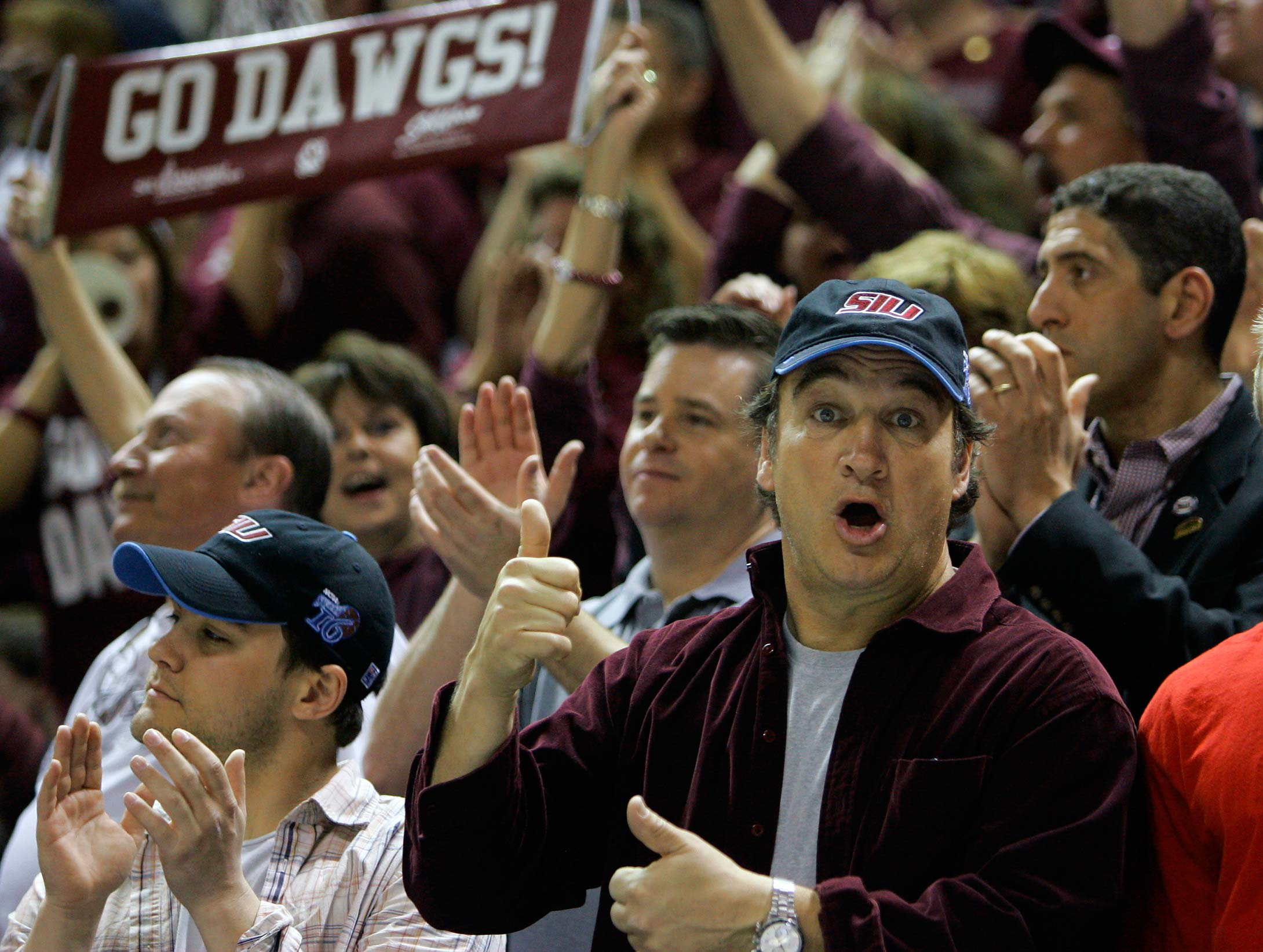 Jim Belushi cheers on Southern Illinois against Kansas during a 2007 West Regional semifinal game in San Jose, Calif.