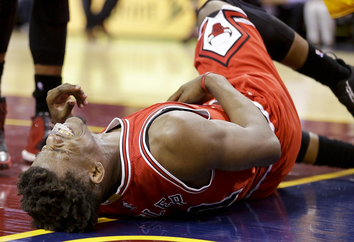 Jimmy Butler of the Chicago Bulls is fouled by the Cavs.