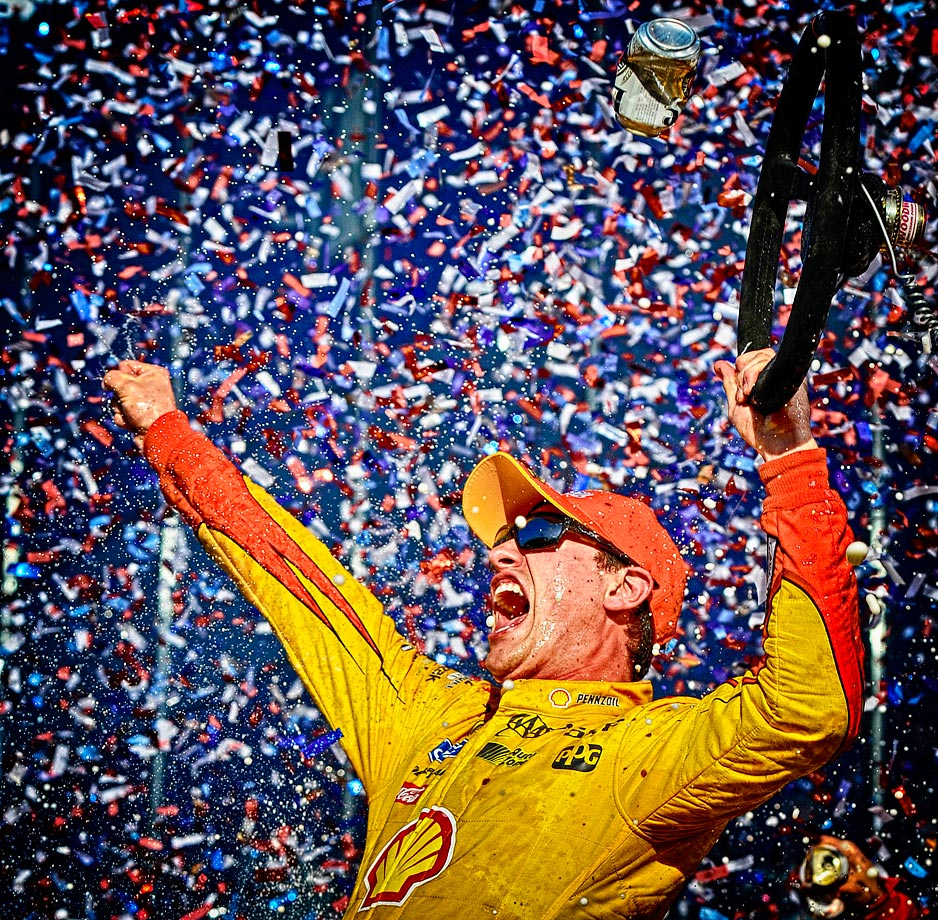 Joey Logano celebrates in victory lane after winning his first Daytona 500.