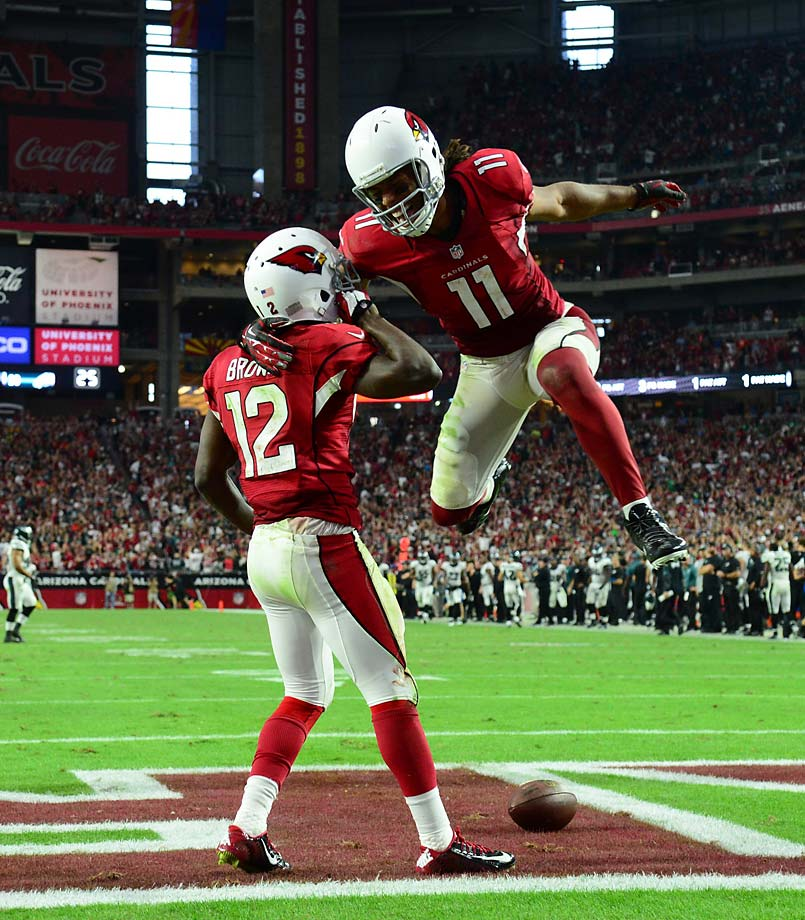 Larry Fitzgerald shows a little excitement after John Brown scored on a 75-yard play to lift Arizona over Philadelphia.