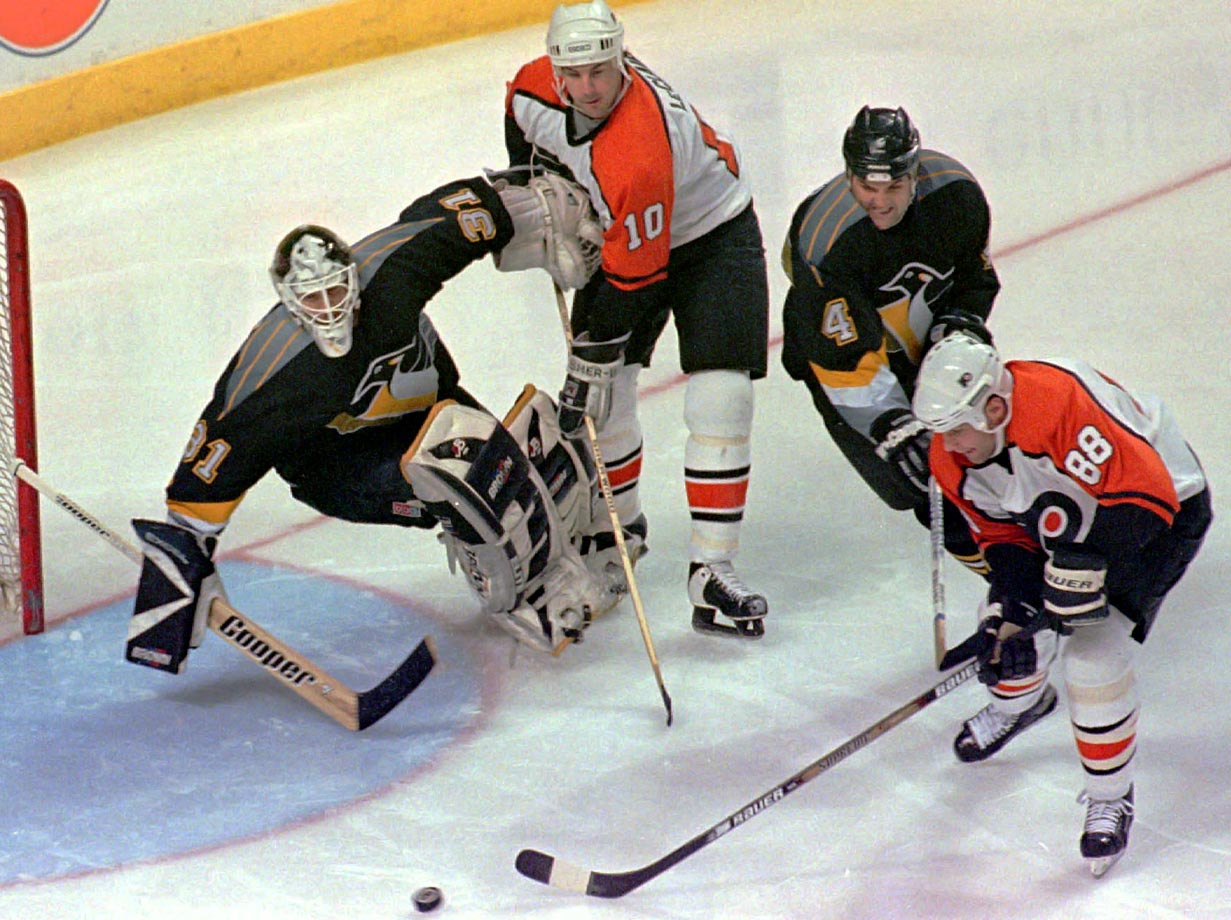 The most prominent members of Philadelphia's feared Legion of Doom Line (which included winger Mikael Renberg), Leclair and Lindros were quintessential power forwards. Created in February 1995, the unit sparked the Flyers to the Eastern Conference Finals as Lindros won the Hart Trophy. The next season, the duo combined for 98 goals and 212 points. A trip the Stanley Cup Final followed in '97 after LeClair posted his second straight 50-goal campaign as Lindros' left wing. The duo remained together until the end of the 2000 season.