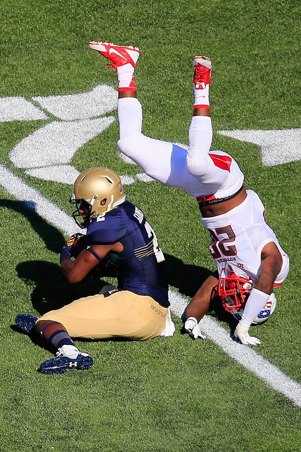 Johnathan Aiken of Rutgers flips over Parrish Gaines of Navy.