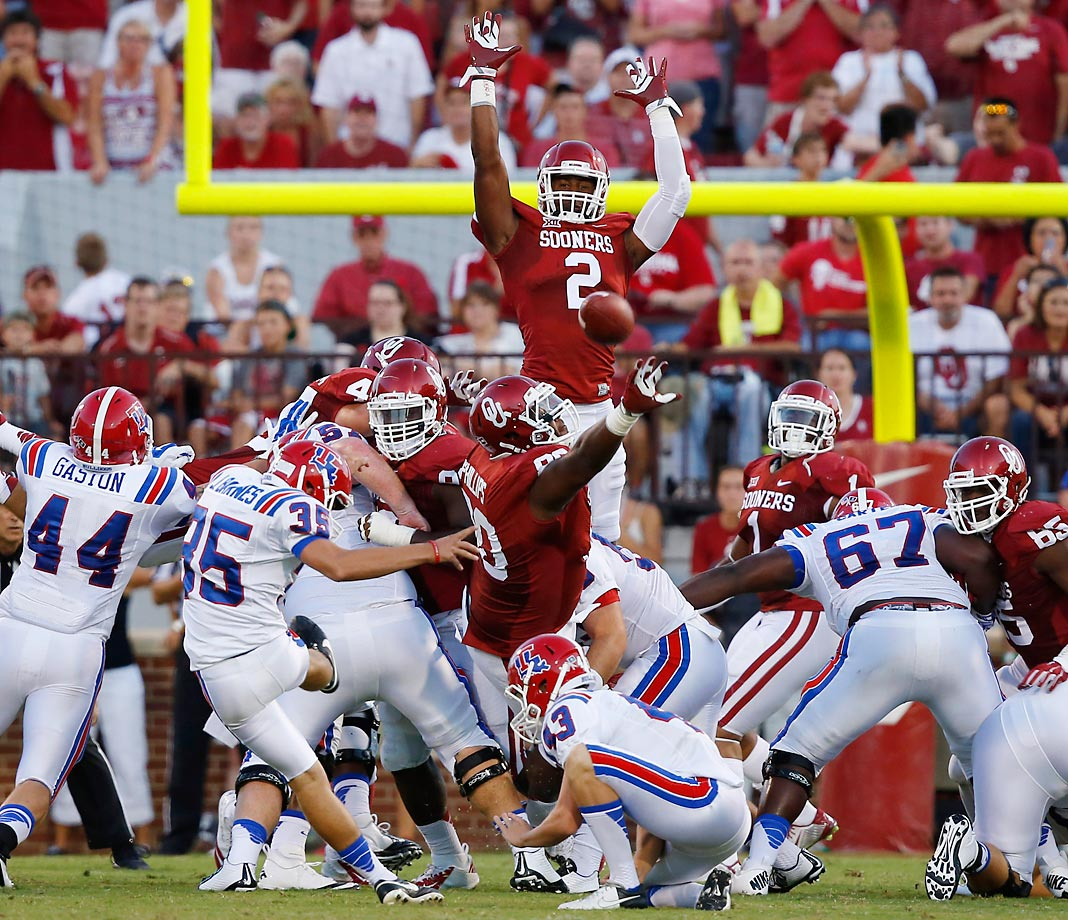 Jonathan Barnes of Louisiana Tech kicks a field goal over Oklahoma safety Julian Wilson (2) in the second quarter on Aug. 30.