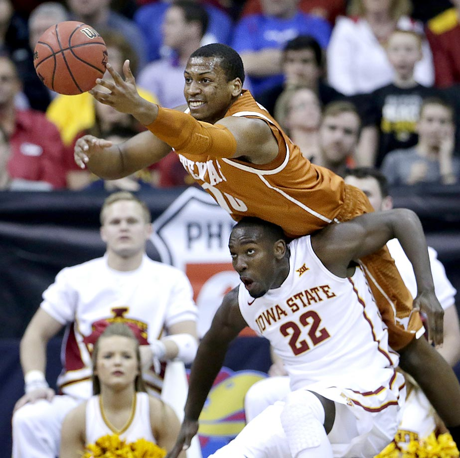 Jonathan Holmes of Texas chases a loose ball against Dustin Hogue of Iowa State.