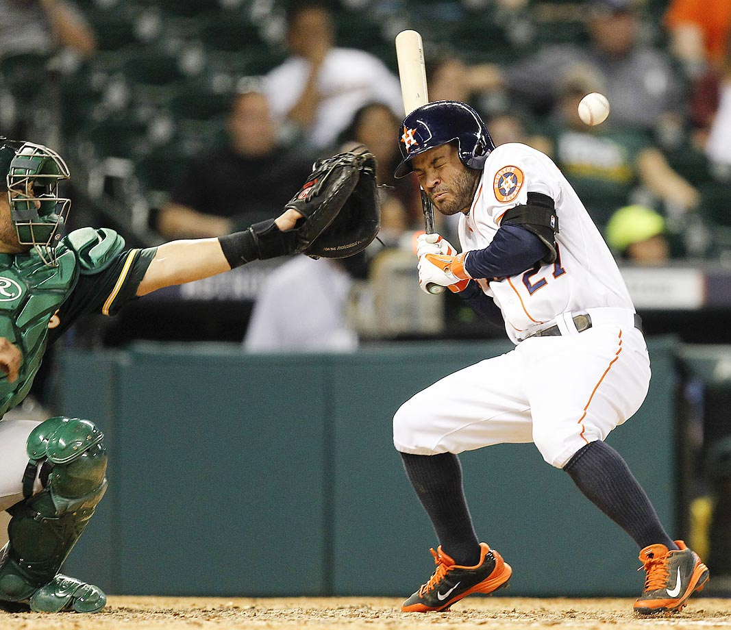 Jose Altuve of the Astros is hit by a pitch in the eighth inning against the Oakland A's on Aug. 26.