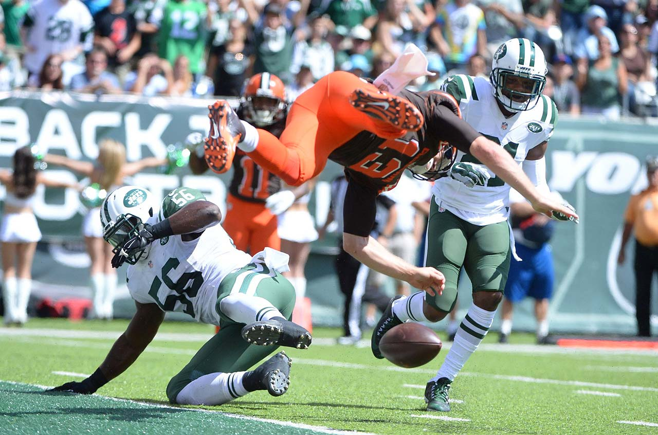 Josh McCown had to undergo concussion protocol after this leap into the end zone against New York.