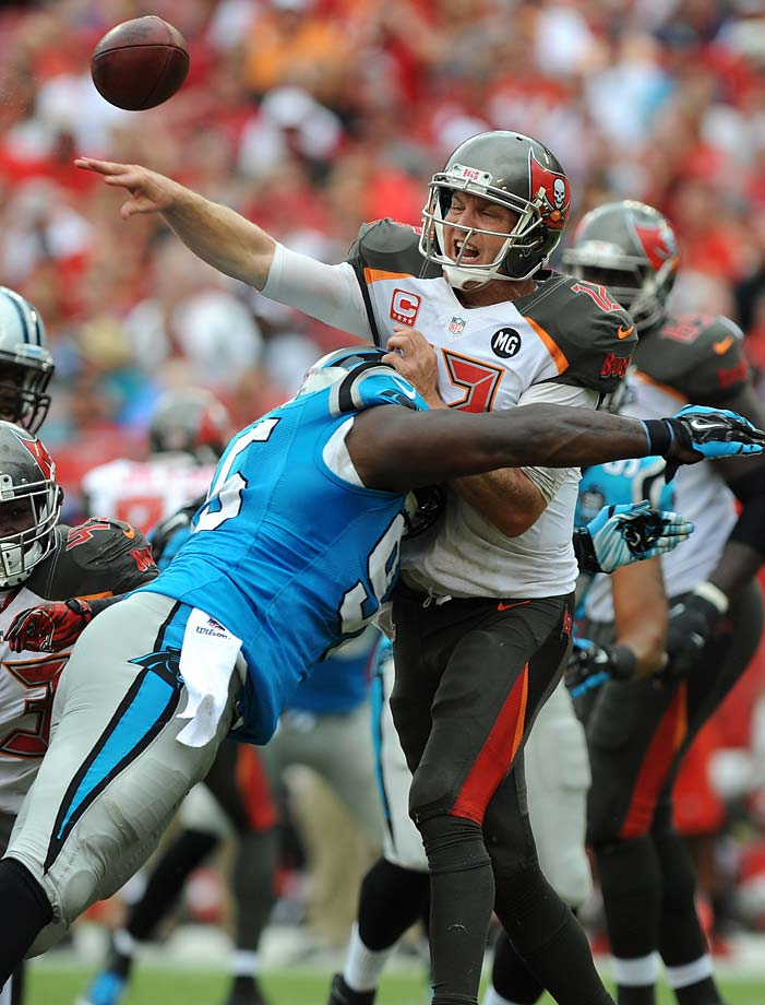 Josh McCown is hit by defensive end Charles Johnson of the Carolina Panthers. McCown threw an interception on the play.
