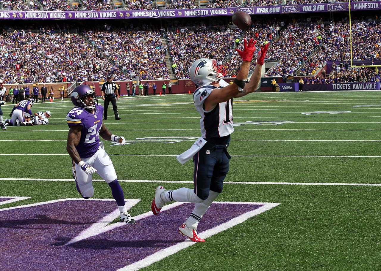 New England Patriots wide receiver Julian Edelman catches a nine-yard touchdown pass as Minnesota Vikings cornerback Captain Munnerlyn gives chase.