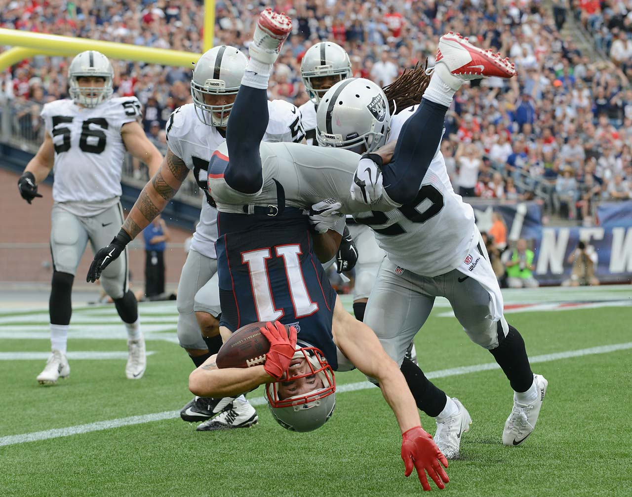 Julian Edelman of the New England Patriots is tackled during the fourth quarter against the Oakland Raiders.