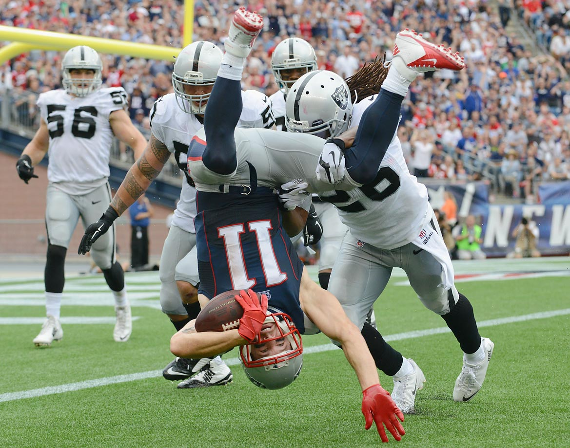 Julian Edelman of the Patriots does a flip in the New England Patriots game against the Oakland Raiders.