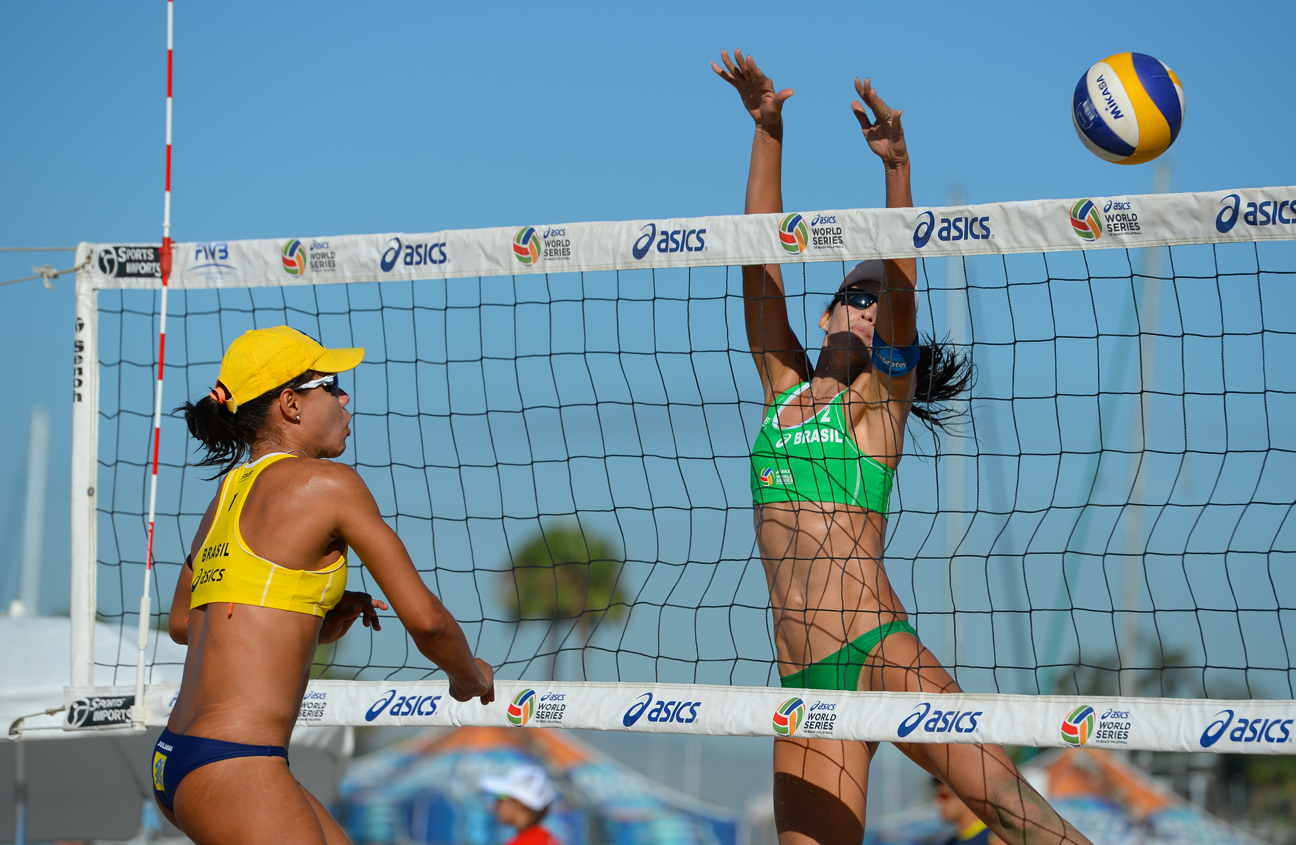 Juliana Felisberta of Brazil spikes against Talita Antunes of Brazil.