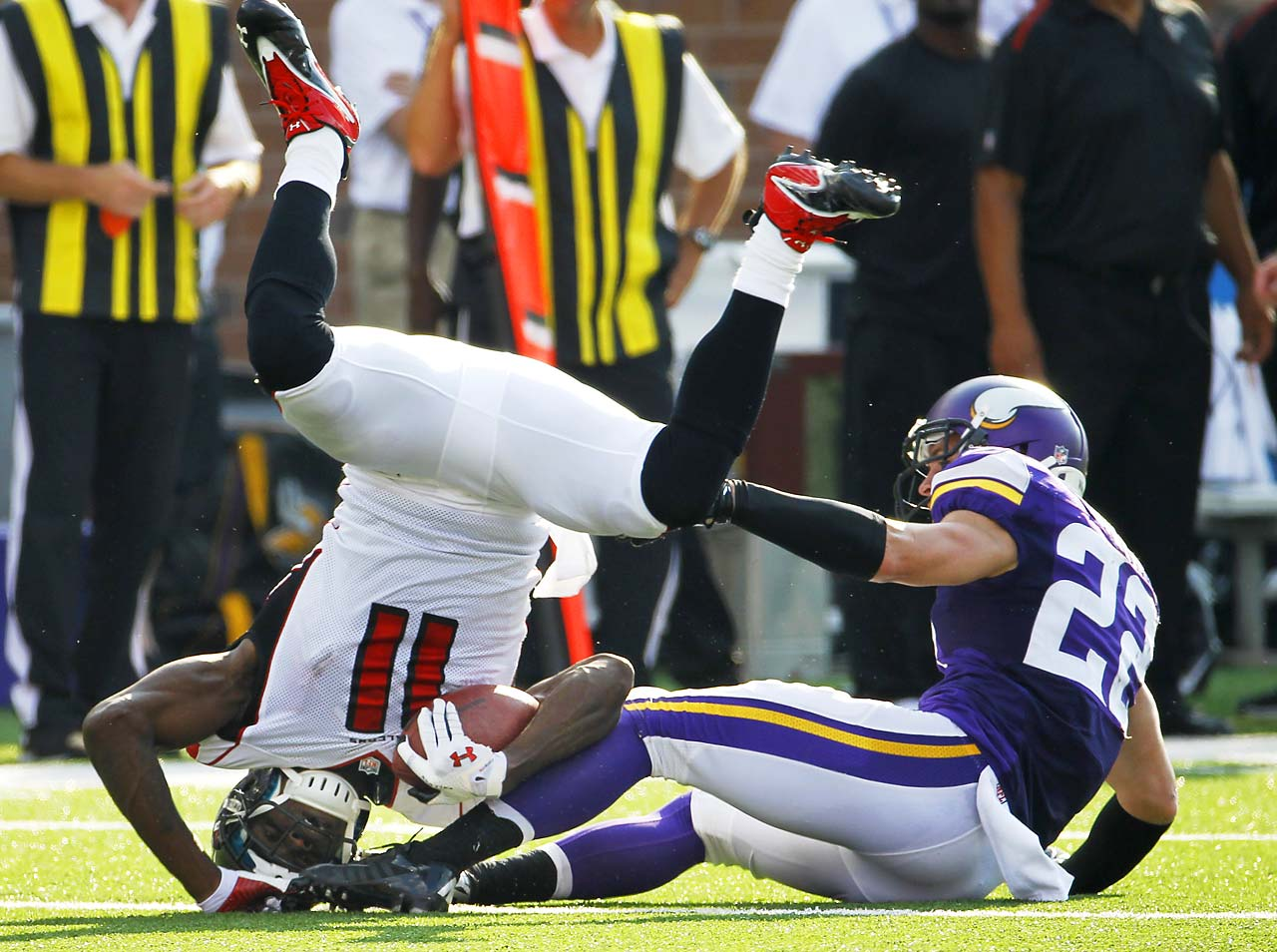 Atlanta wide receiver Julio Jones is tackled by Minnesota Vikings free safety Harrison Smith during the Falcons loss in Minneapolis.