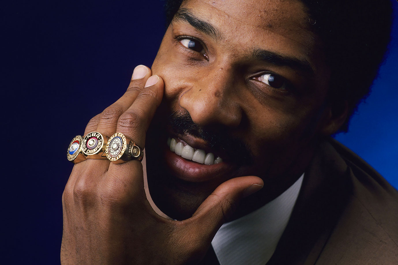 Dr. J shows off his three championship rings.