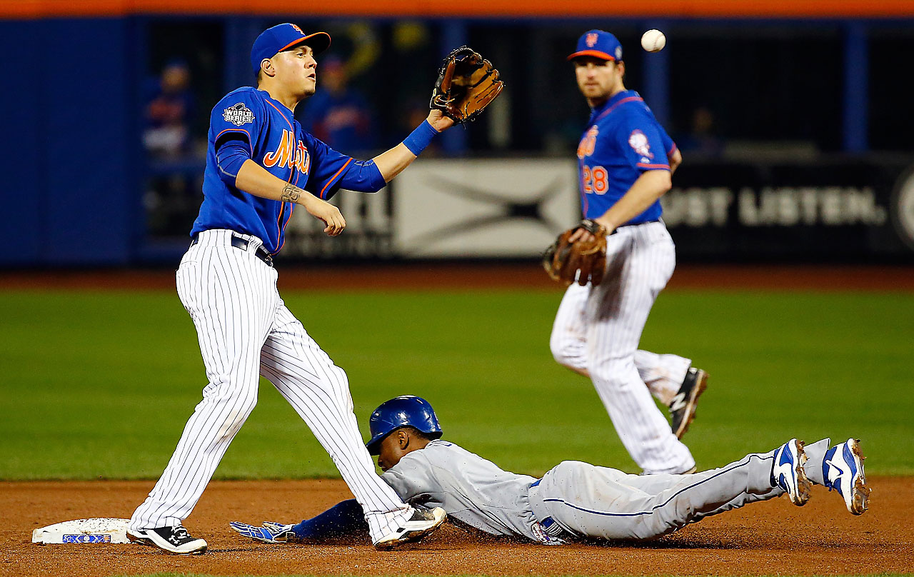 Jarrod Dyson of the Kansas City Royals steals second base in the 12th inning against the New York Mets. He would eventually scored the go-ahead run.