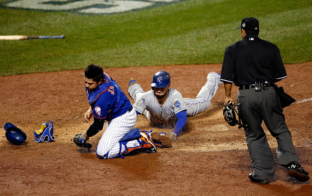 Eric Hosmer scores a run off of a grounded out hit by Salvador Perez to tie the game at 2-2 in the ninth inning.