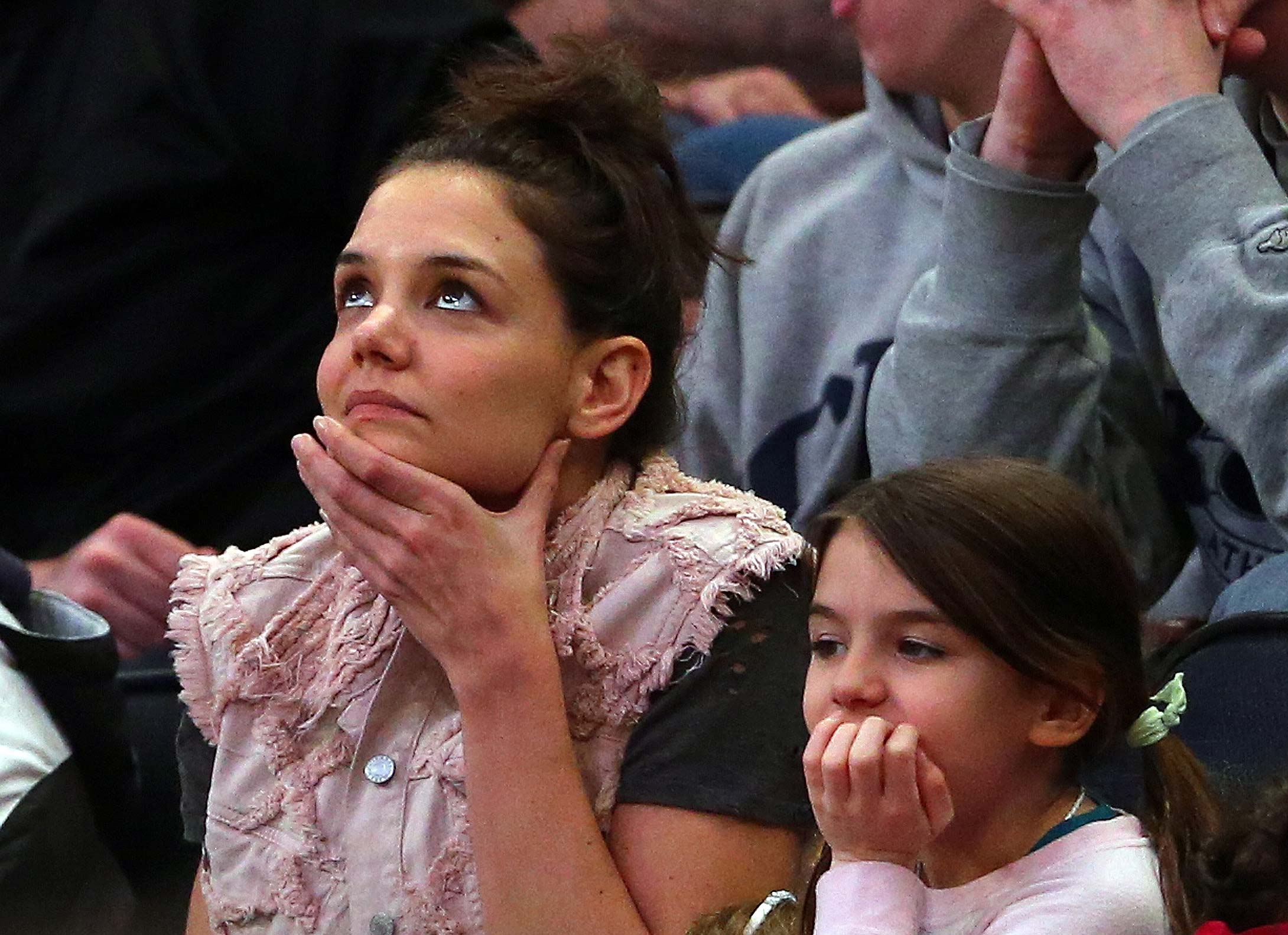 Katie Holmes and her daughter Suri Cruise attend the 2014 East Regional Final between the Connecticut Huskies and the Michigan State Spartans at Madison Square Garden.
