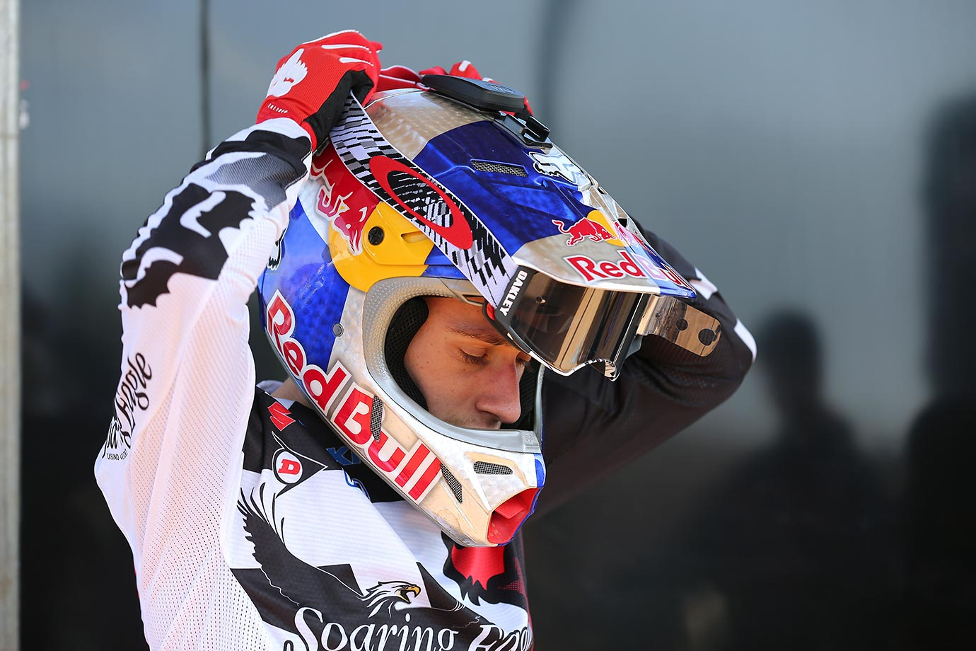Ken Roczen straps his helmet on before heading out to the track for practice.