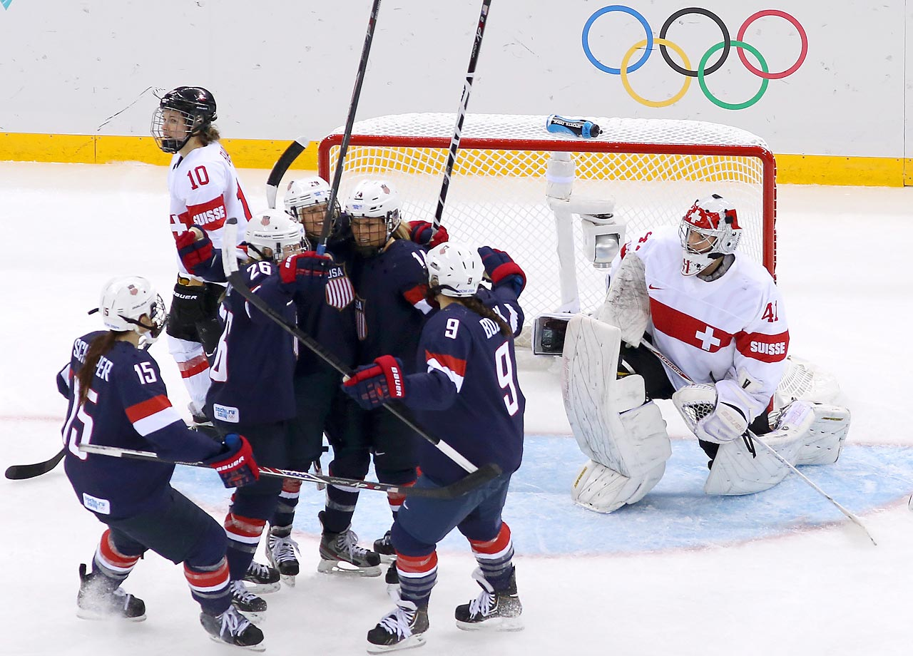 Kendall Coyne celebrates with teammates after scoring the U.S.'s seventh goal.