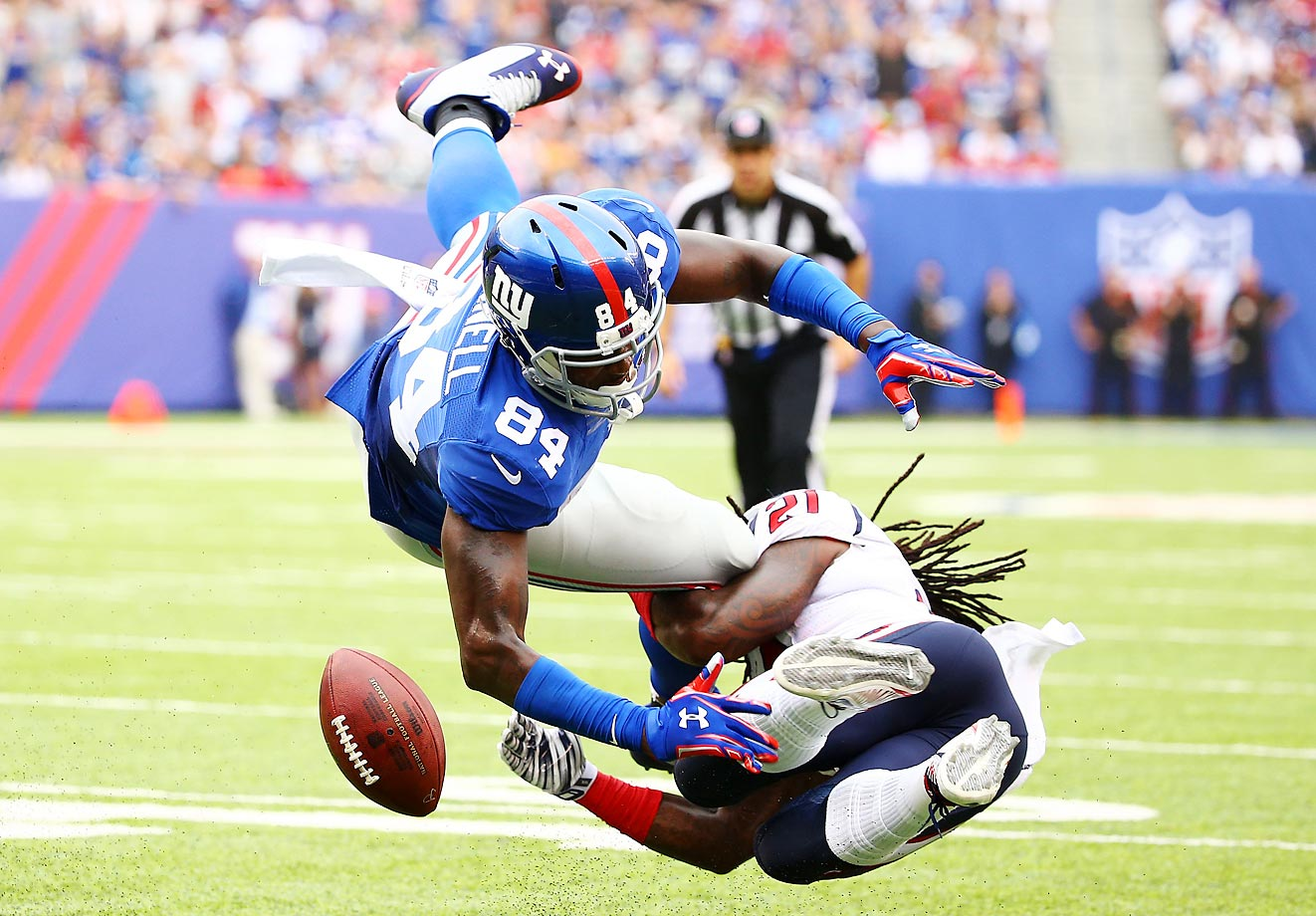 Kendrick Lewis of the Texans hits Larry Donnell in the first quarter.  The Giants won 30-17 on Sunday.