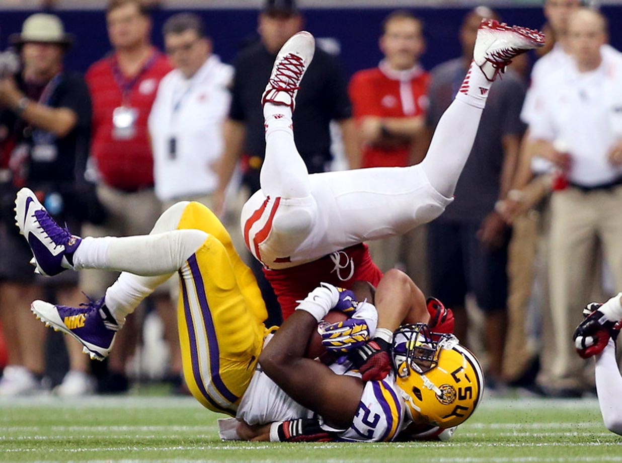 Kenny Hilliard of LSU is tackled by Joe Schobert of Wisconsin. LSU won 28-24 on Saturday.