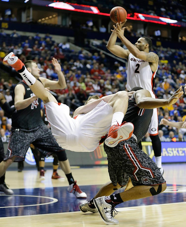 Georgia forward Kenny Paul Geno flies over the back of South Carolina guard Sindarius Thornwell in the quarterfinal round of the Southeastern Conference tournament.