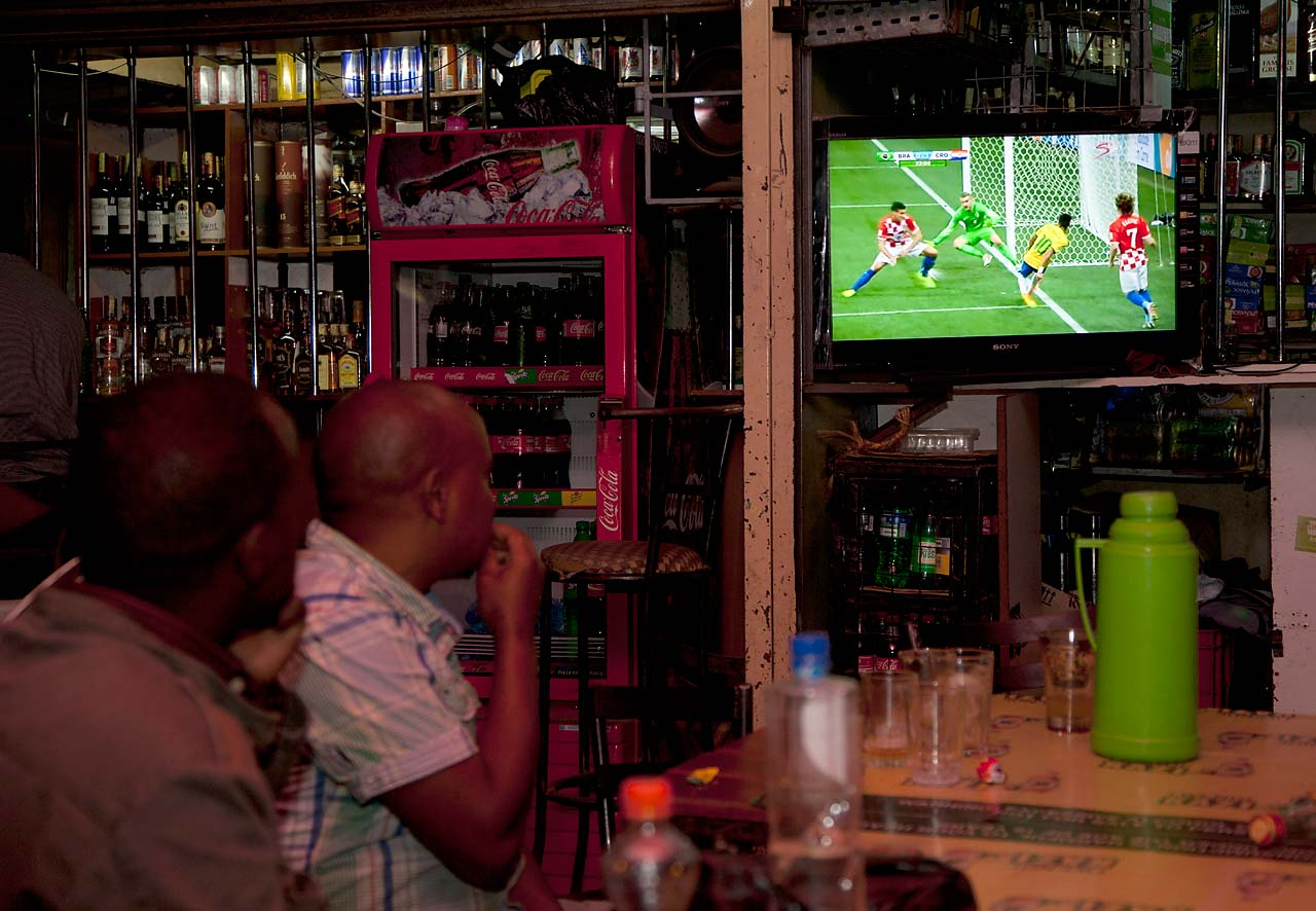 Kenyan soccer fans watch Brazil play Croatia in the World Cup opening match.