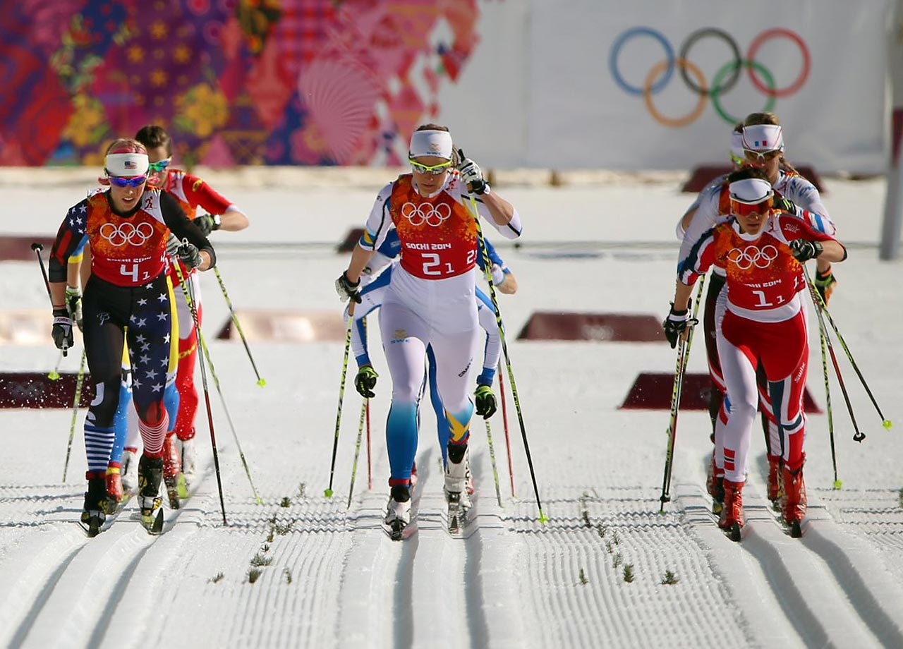 Ida Ingemarsdotter of Sweden (bib 2), Heidi Weng of Norway (bib 1) and Kikkan Randall of the U.S.  during the first leg of the Cross Country Relay 4x5 km.