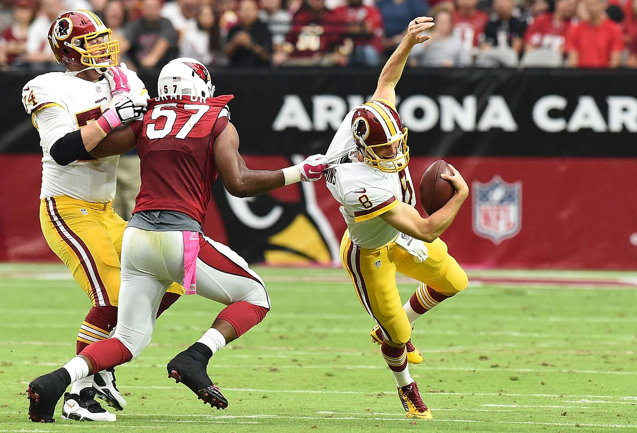 Kirk Cousins of the Washington Redskins is grabbed by the jersey by linebacker Alex Okafor of the Arizona Cardinals.