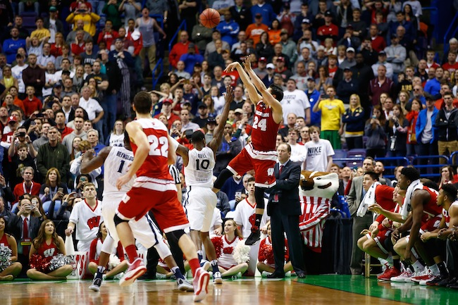 "Wisconsin's Bronson Koenig sank two threes in the final 14 seconds of his team's win over Xavier, including the game-winner with less than one tick left on the clock! After struggling to score in the Big Ten tournament and putting up only two points in the first round, Koenig hit six threes and had 20 points in the Badgers' win over Xavier. Koenig hit the game-winner while falling out-of-bounds due to the tough-all-night defense of Xavier guard Remy Abell, who could only quietly explain this one second of madness by saying, ""Great defense. Better offense."""