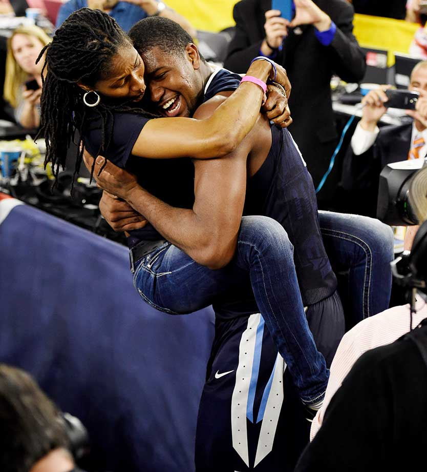 Kris Jenkins and his mom celebrate after his clutch shot.
